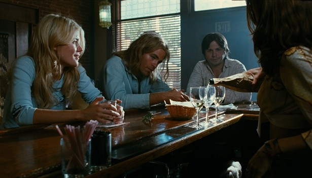 Bo Barrett and Sam Fulton taste wine at a bar.