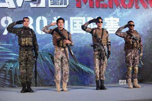 Cop-erators salute at a promo event for the film.